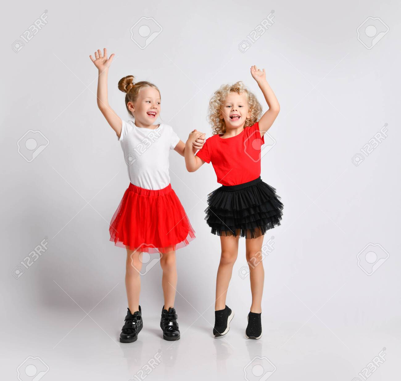 Active Happy Kids Girls Friends Sisters In Red And Black Skirts.. Stock  Photo, Picture And Royalty Free Image. Image 135409664.