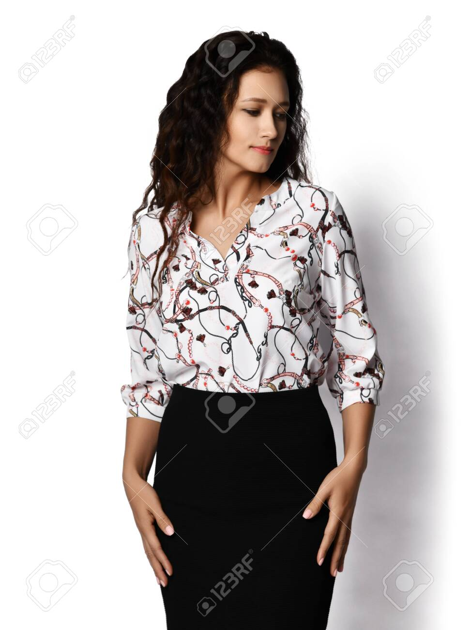 Young woman with curly brunette hair in business style wear white..