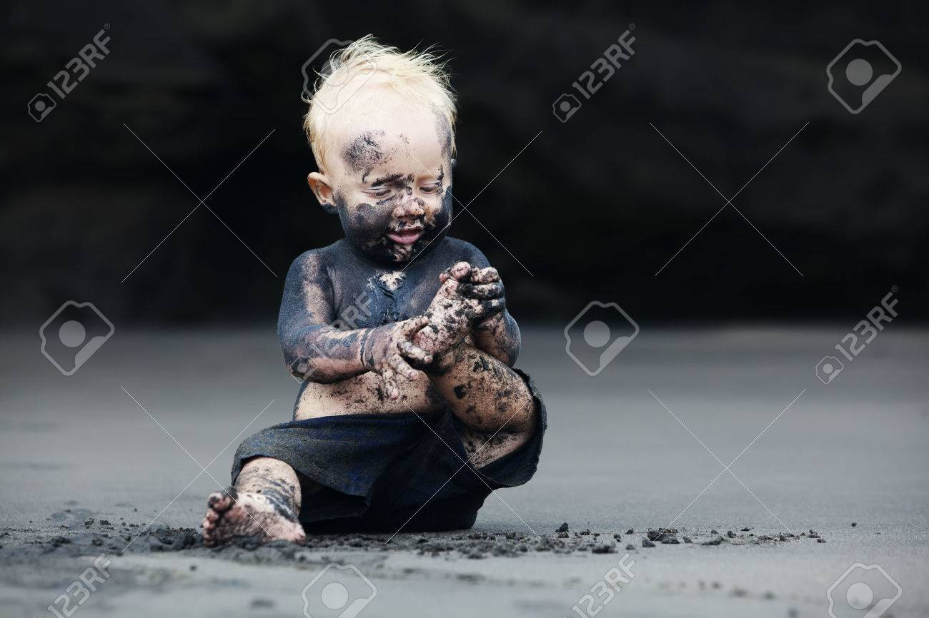 Funny Portrait Of Smiling Child With Dirty Face Sitting And ...