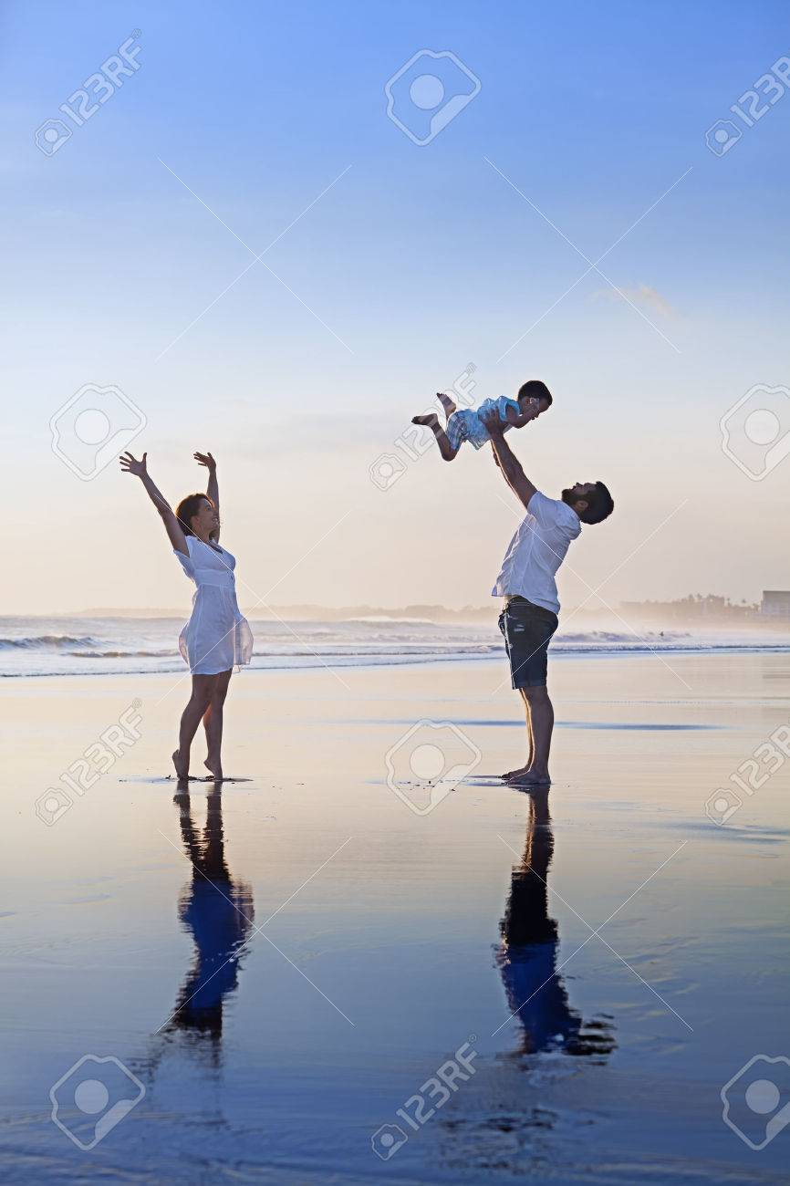 Positive Family - Father, Mother With Baby Son Relax With Fun ...
