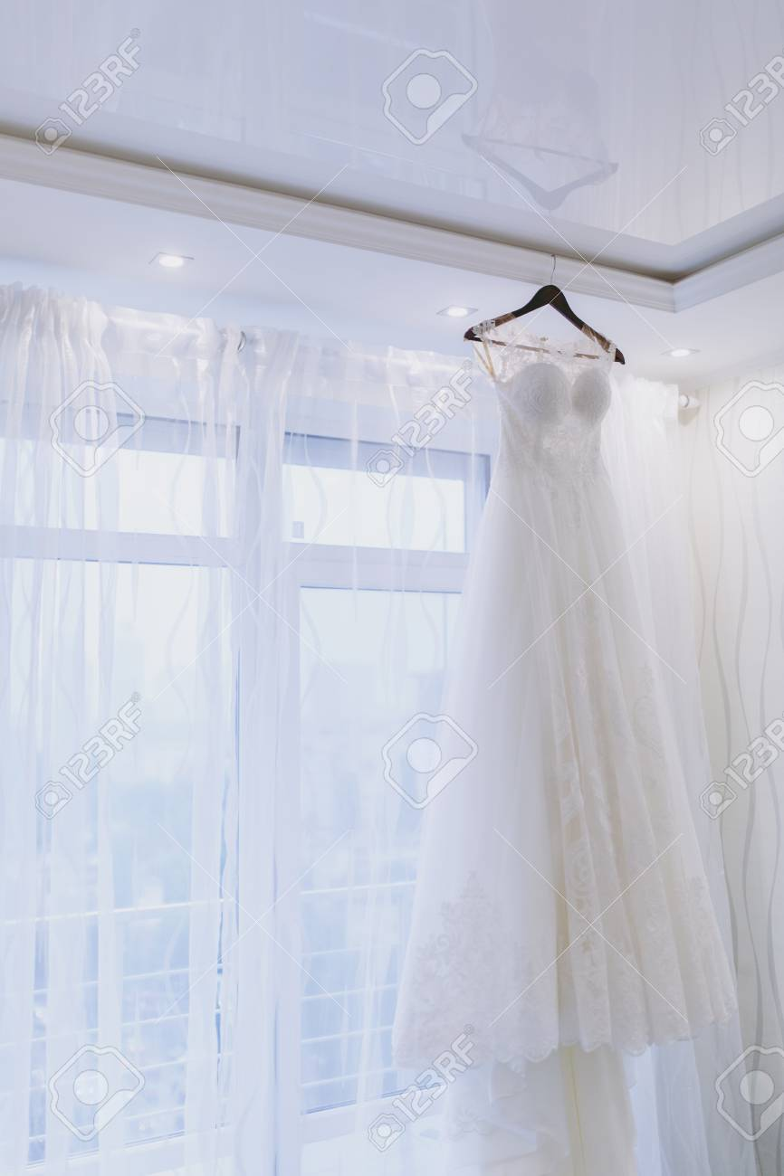 9f19e5bedac A beautiful tender elegant wedding dress with lace and short sleeves for  the bride hangs on
