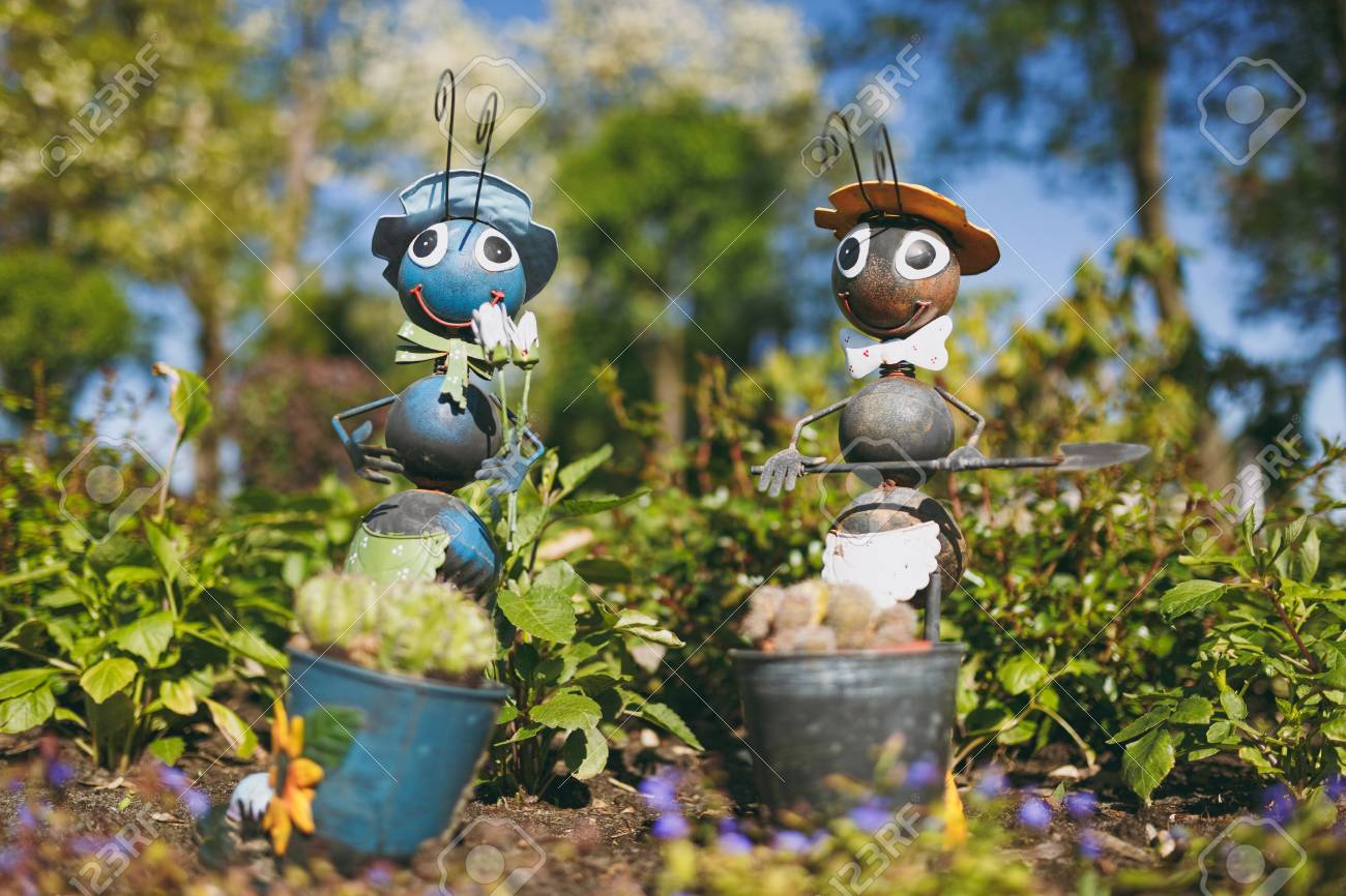 Stock Photo - Two decorative garden funny cute sweet ants in hat bow tie with shovel in flower pot with cactus decorating yard. & Two Decorative Garden Funny Cute Sweet Ants In Hat Bow Tie With ...
