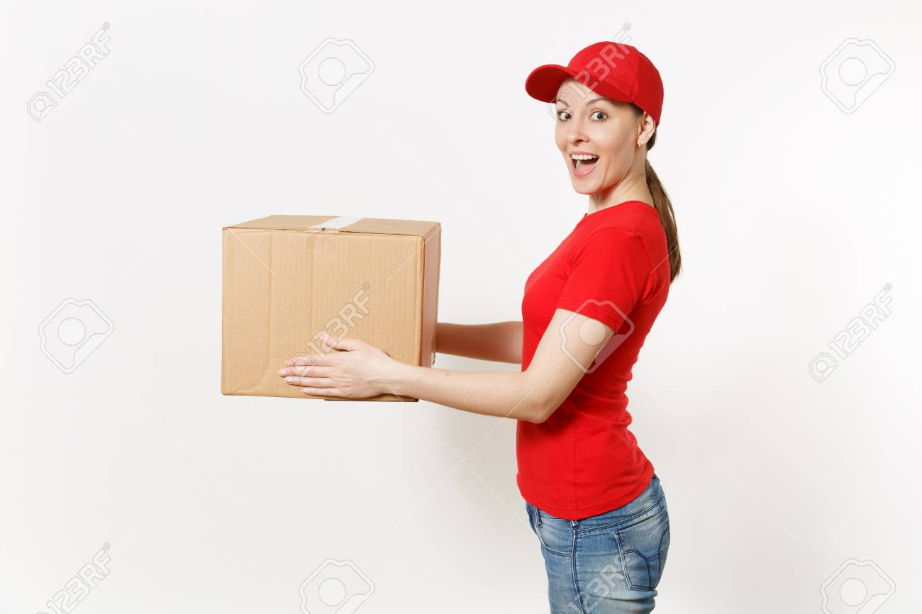 Delivery woman in red uniform isolated on white background. Female in cap, t-shirt, jeans working as courier or dealer holding cardboard box. Receiving package. Copy space advertisement. Side view - 103228226
