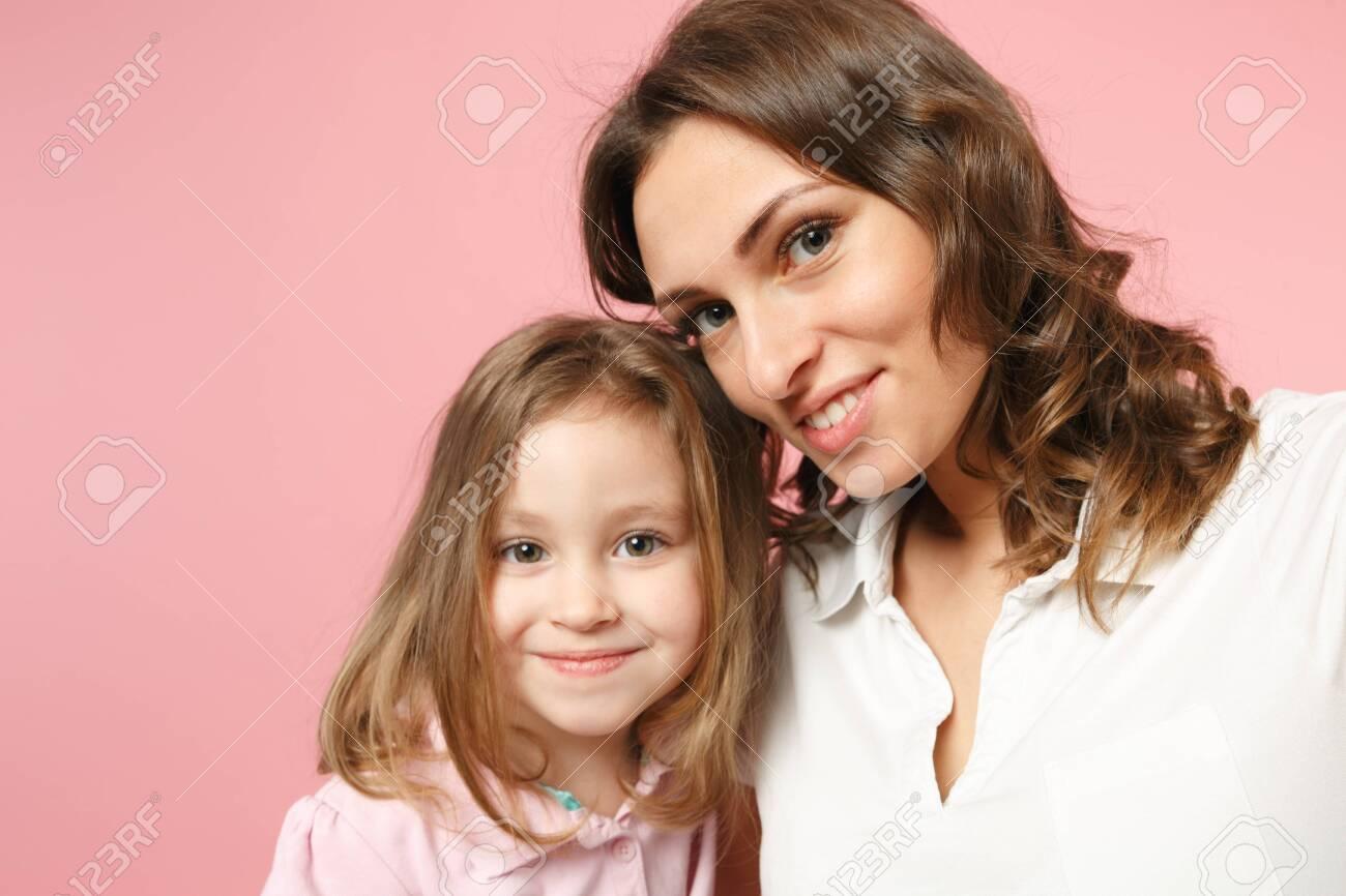Close up selfie shot woman in light clothes have fun with cute child baby girl. Mother, little kid daughter isolated on pastel pink wall background, studio portrait. Mother's Day, love family concept - 121031085
