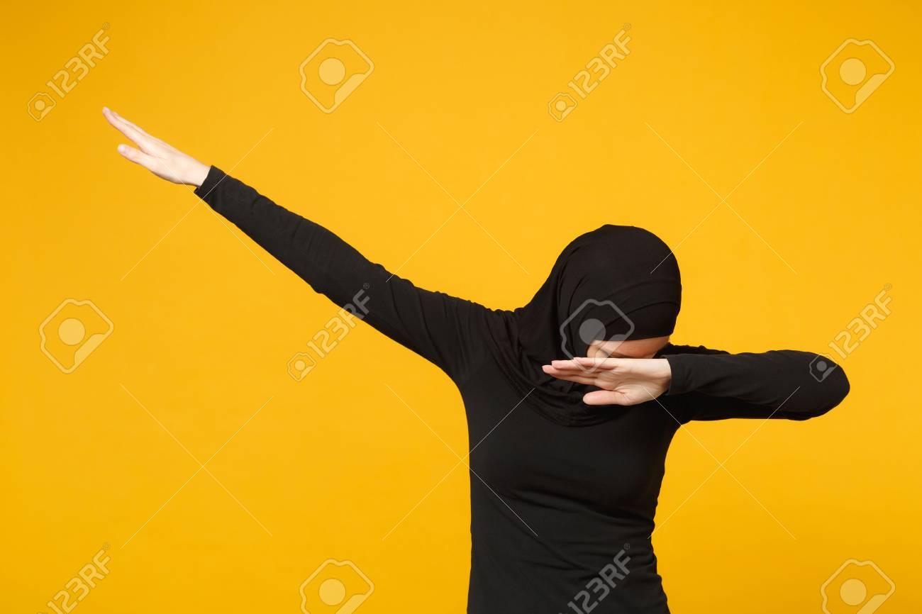 Young teen arabian muslim woman in hijab black clothes doing