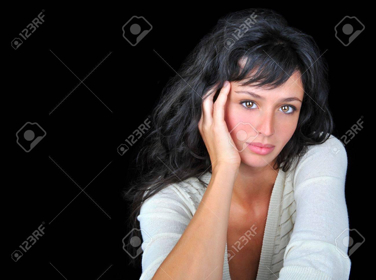 Beautiful brunette fashion model on black background. Stock Photo - 7094737