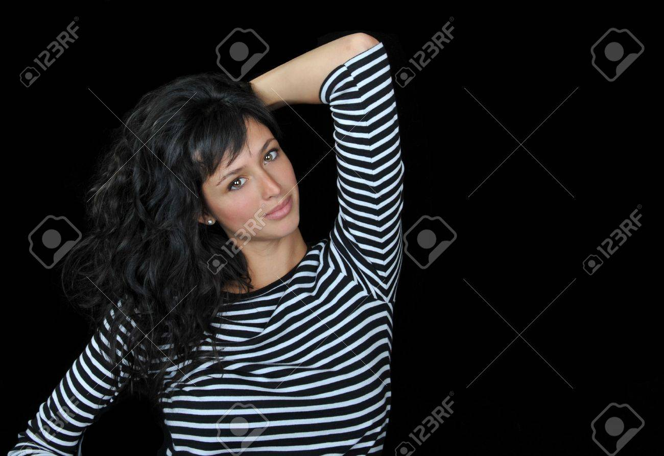 Beautiful brunette fashion model on black background. Stock Photo - 7094729