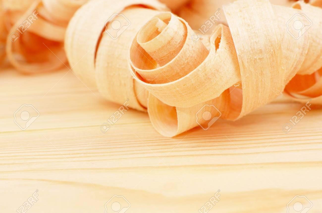 Fresh shaving on the natural pine plank Stock Photo - 11432846