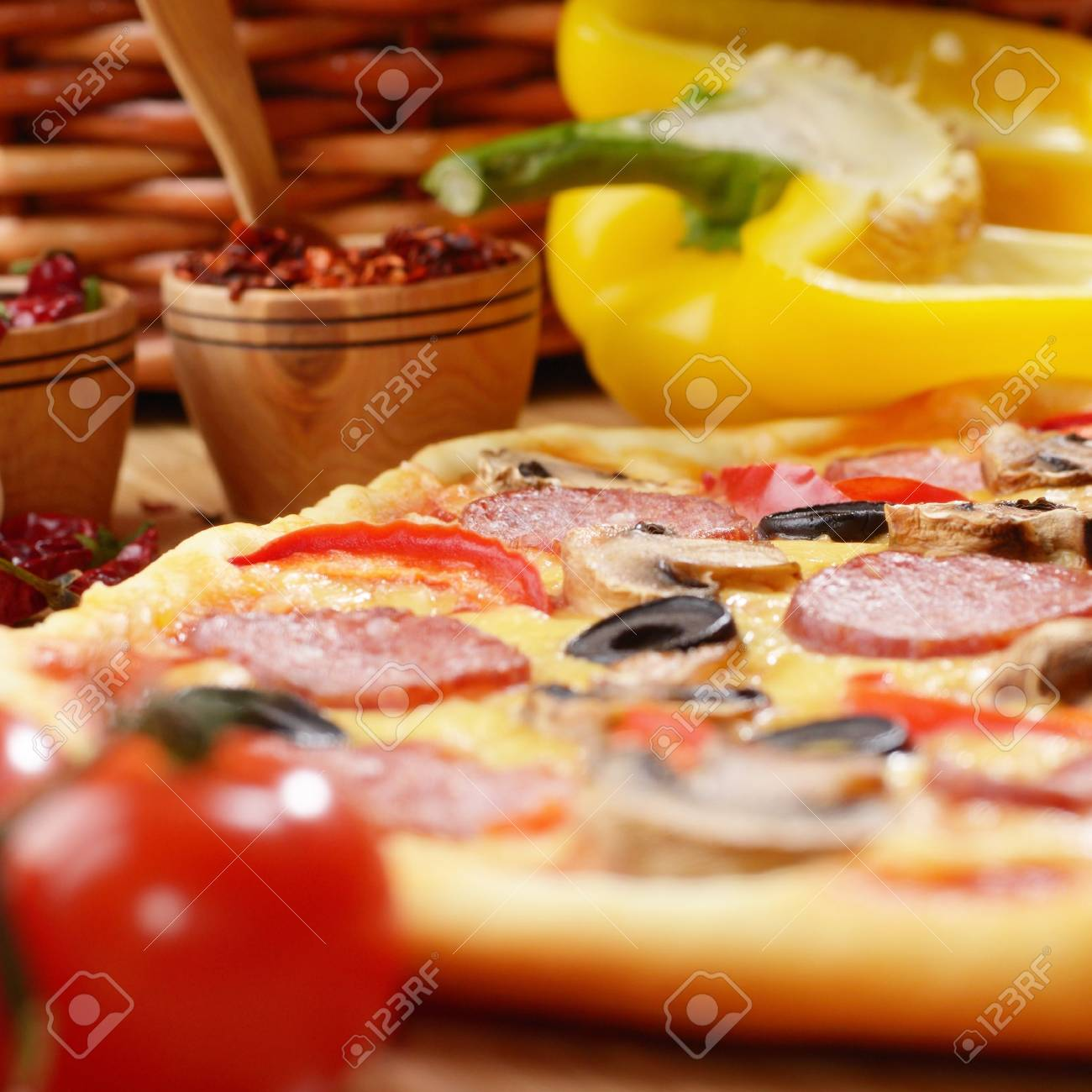 Pepperoni pizza with cherry and mushrooms on the bamboo kitchen table Stock Photo - 11770849