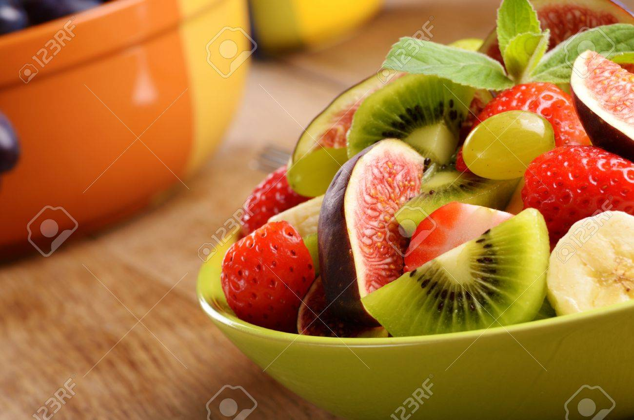 Healthy fruit mix salad on the kitchen table with copy-space Stock Photo - 15712872