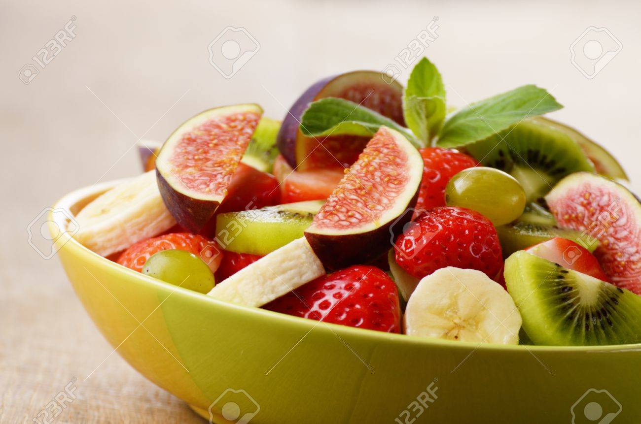 Healthy fruit mix salad on the kitchen table Stock Photo - 16214693