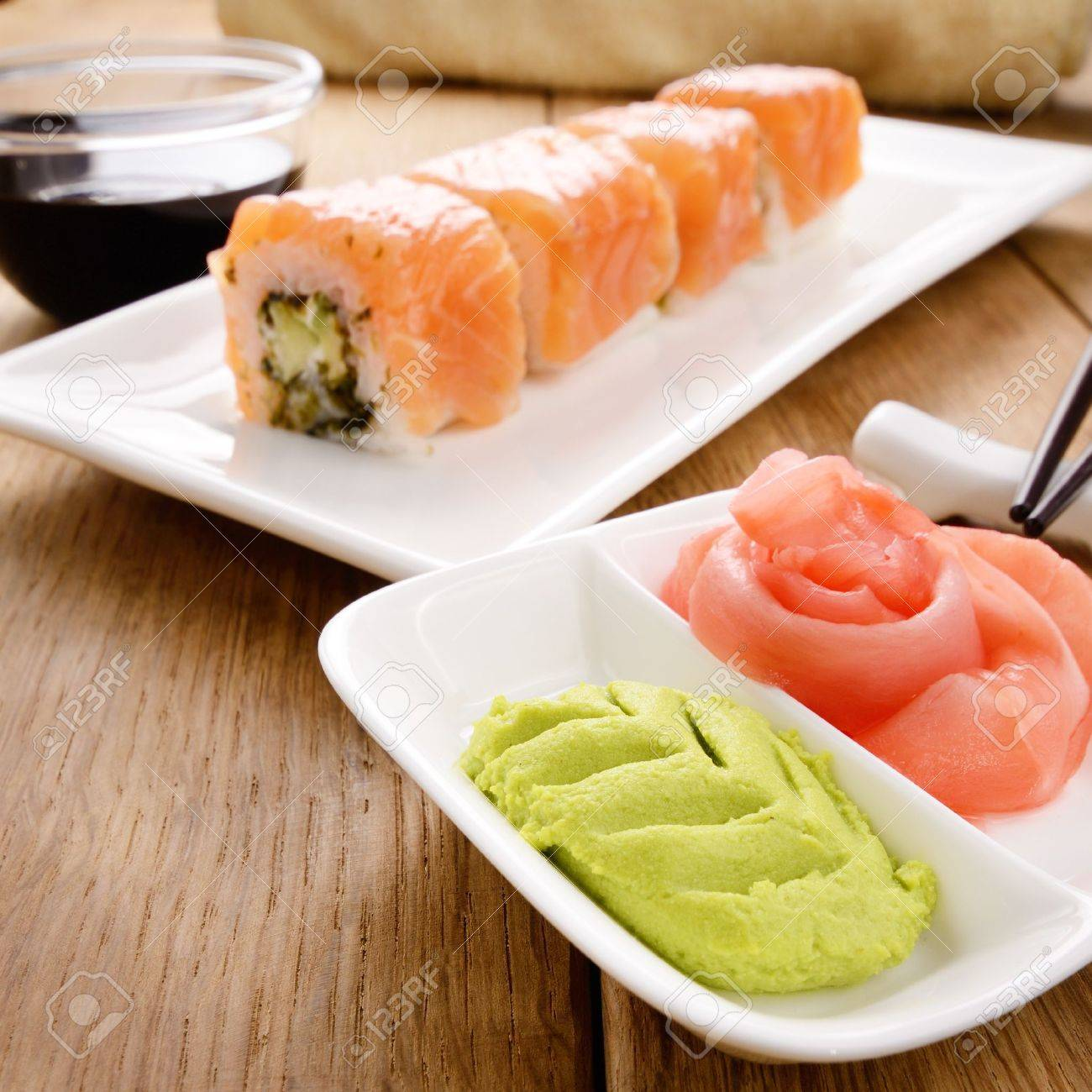 Philadelphia roll sushi on a white plate with soy sauce wasabi and ginger Stock Photo - 17563366