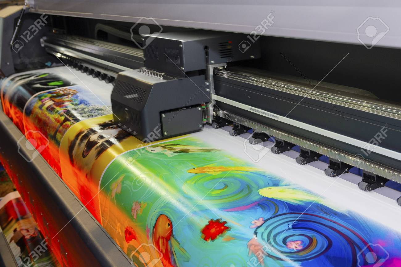 Large format printing machine in operation. Industry - 123903393