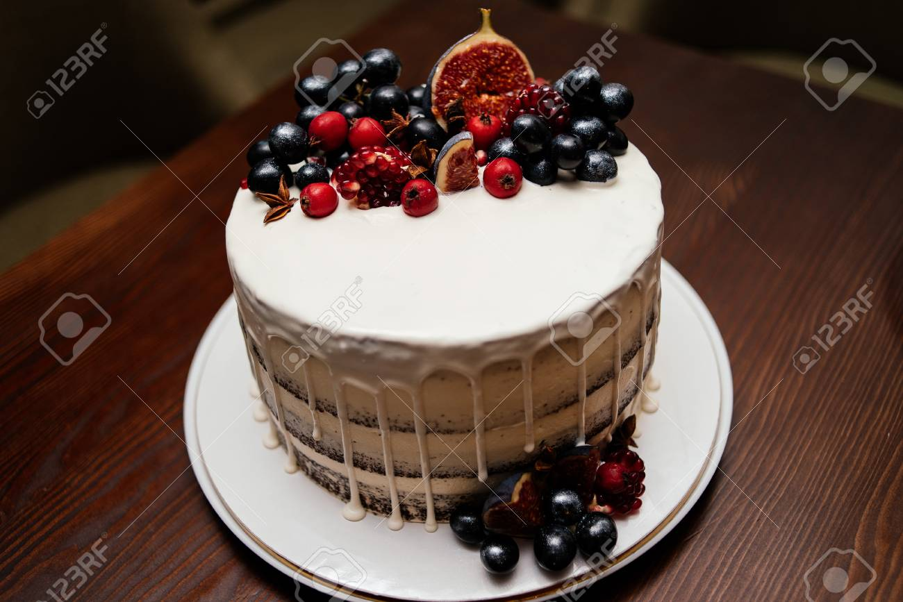 Birthday Cake Decorated With Fresh Fruit On A White Plate Wooden Table