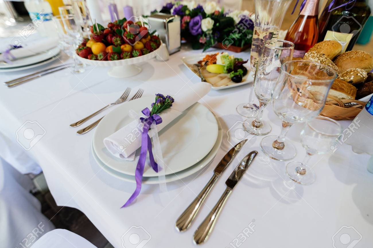 White Napkin With Purple Flowers On A White Empty Plate On A.. Stock ...