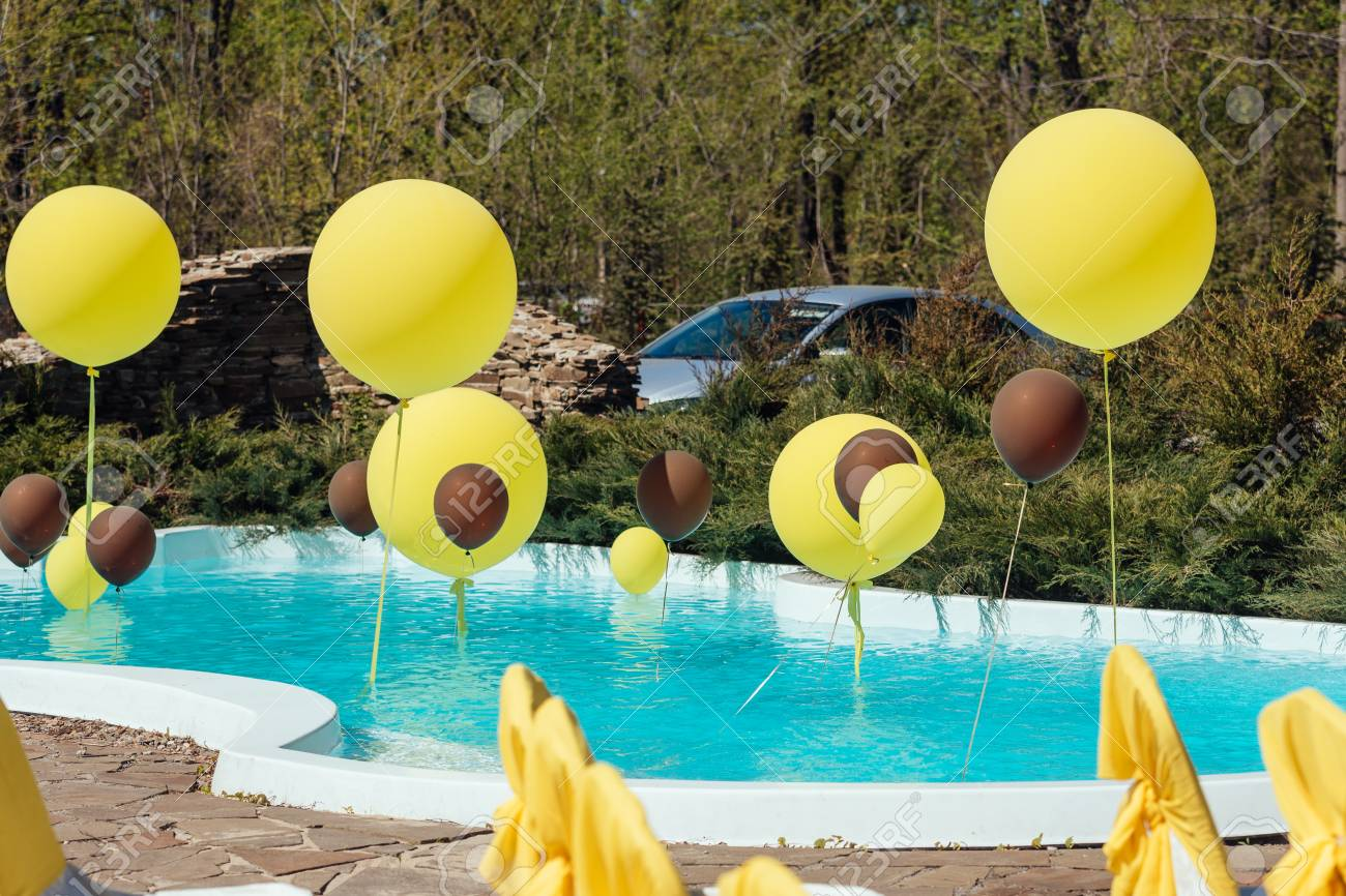 Pool With Big Yellow And Brown Balloons Outdoor Poolside Party