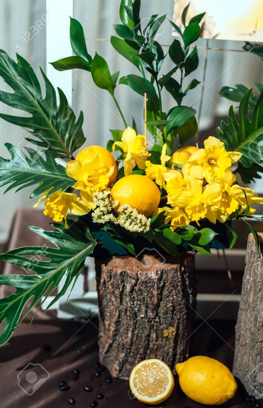 Wedding Flower Arrangements Of Yellow Daffodils Greenery And