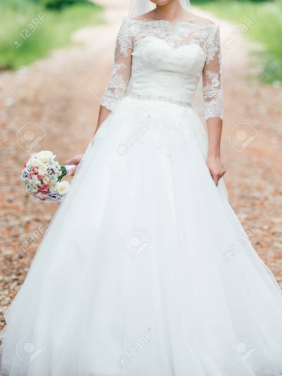Beautiful Bride In White Lace Wedding Dress With Wedding Bouquet ...