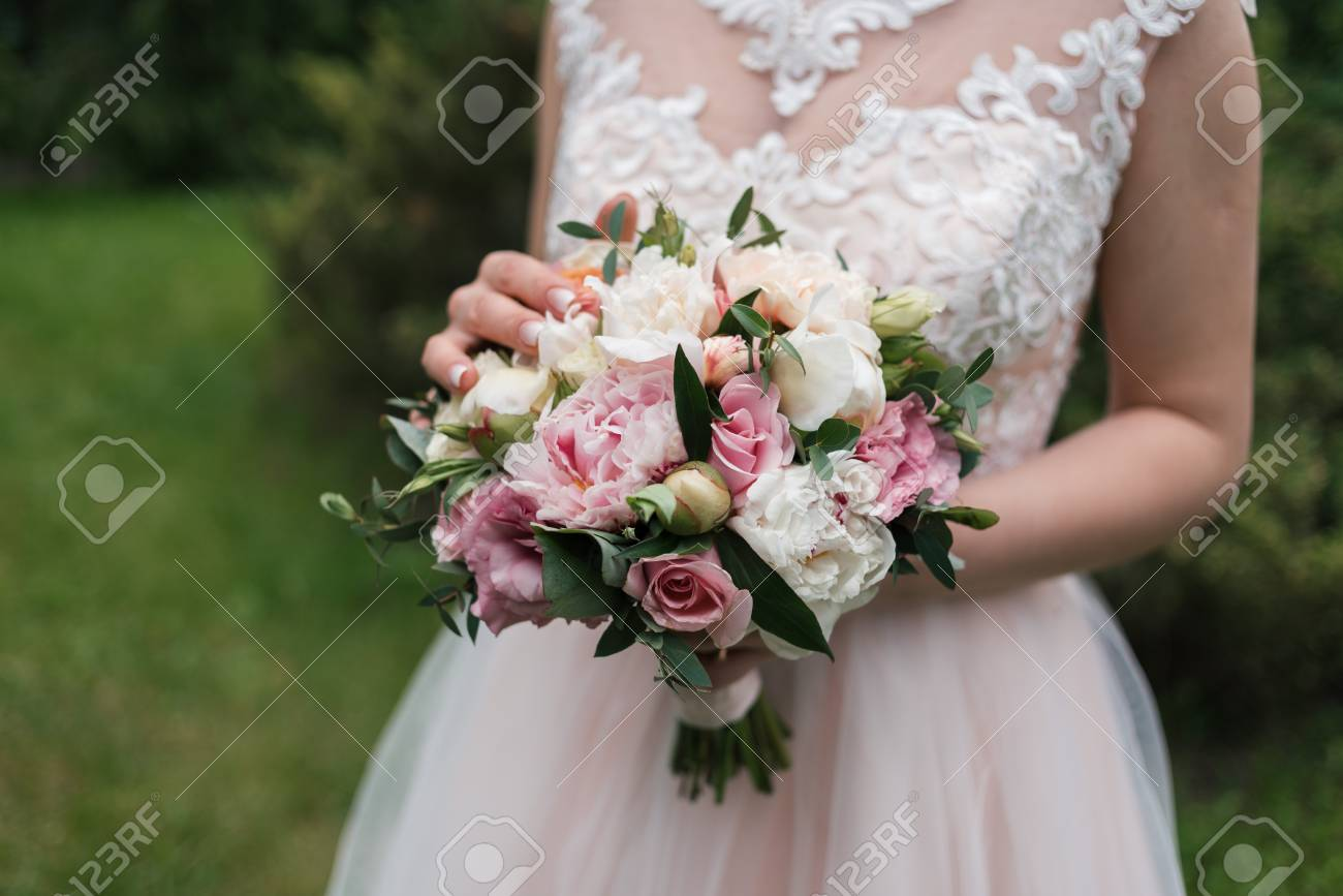 Lush Wedding Bouquet Of White And Pink Peonies Roses And Greenery Stock Photo Picture And Royalty Free Image Image 98771742