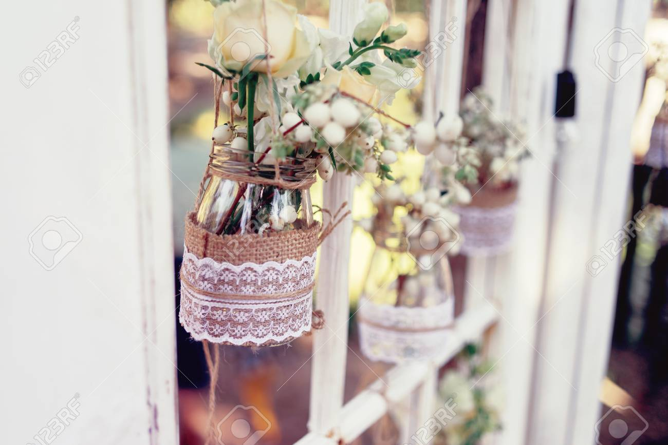 Little Wedding Floral Decorations In Rustic Style Hang In Jars