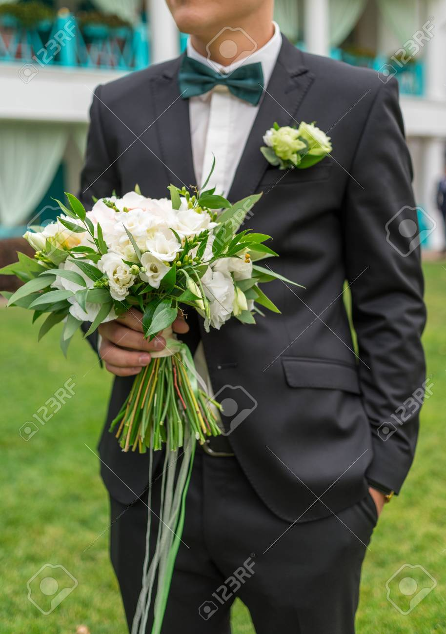 Bridal Wedding Bouquet Of White Flowers And Greenery With Ribbons