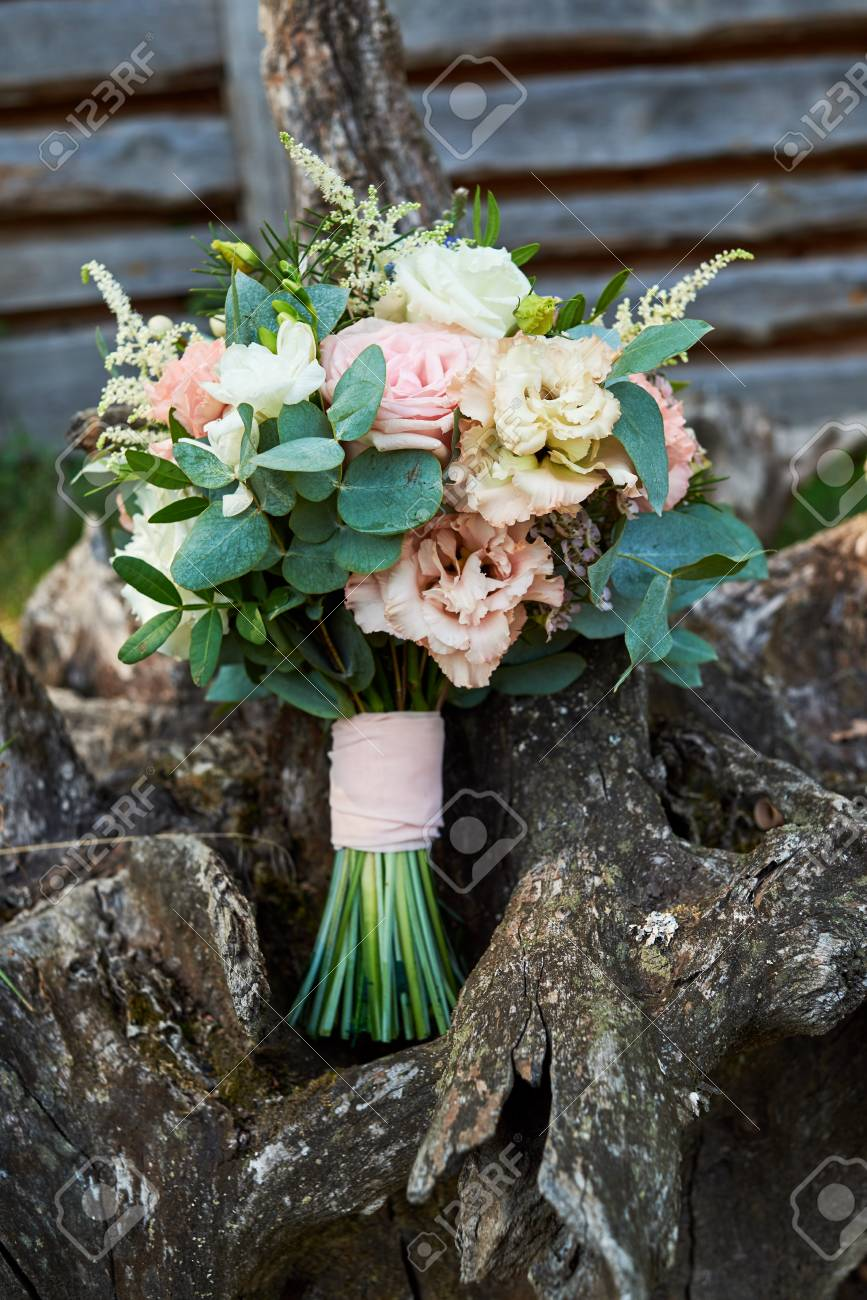 Beautiful Wedding Bouquet Of Fresh White And Pink Roses Blue