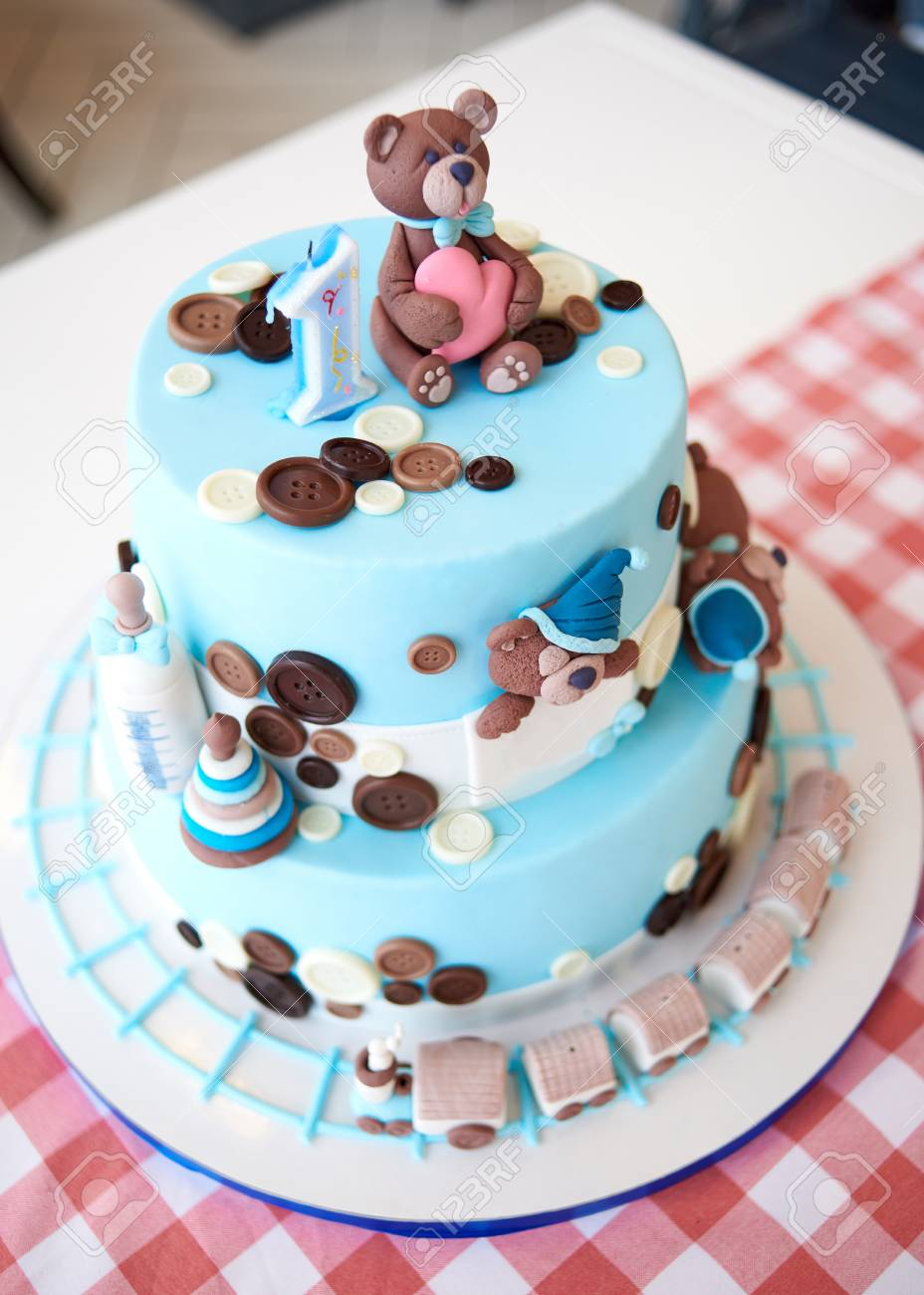 Round Multi Tiered Blue Birthday Cake Decorated With Button Stock