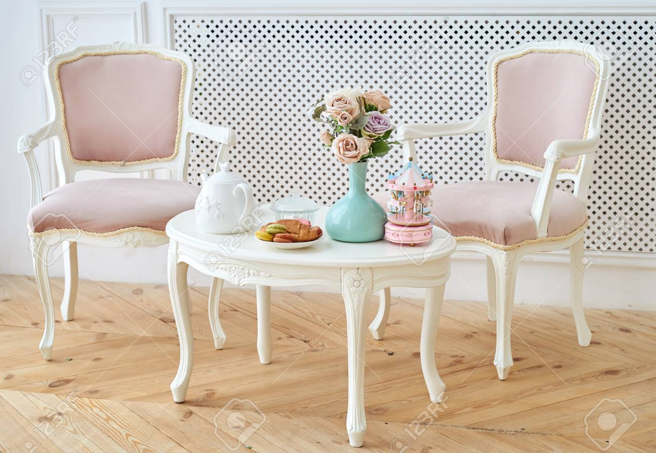 Pink Round Table.Two Pink Soft Chairs And White Wooden Round Table With Breakfast