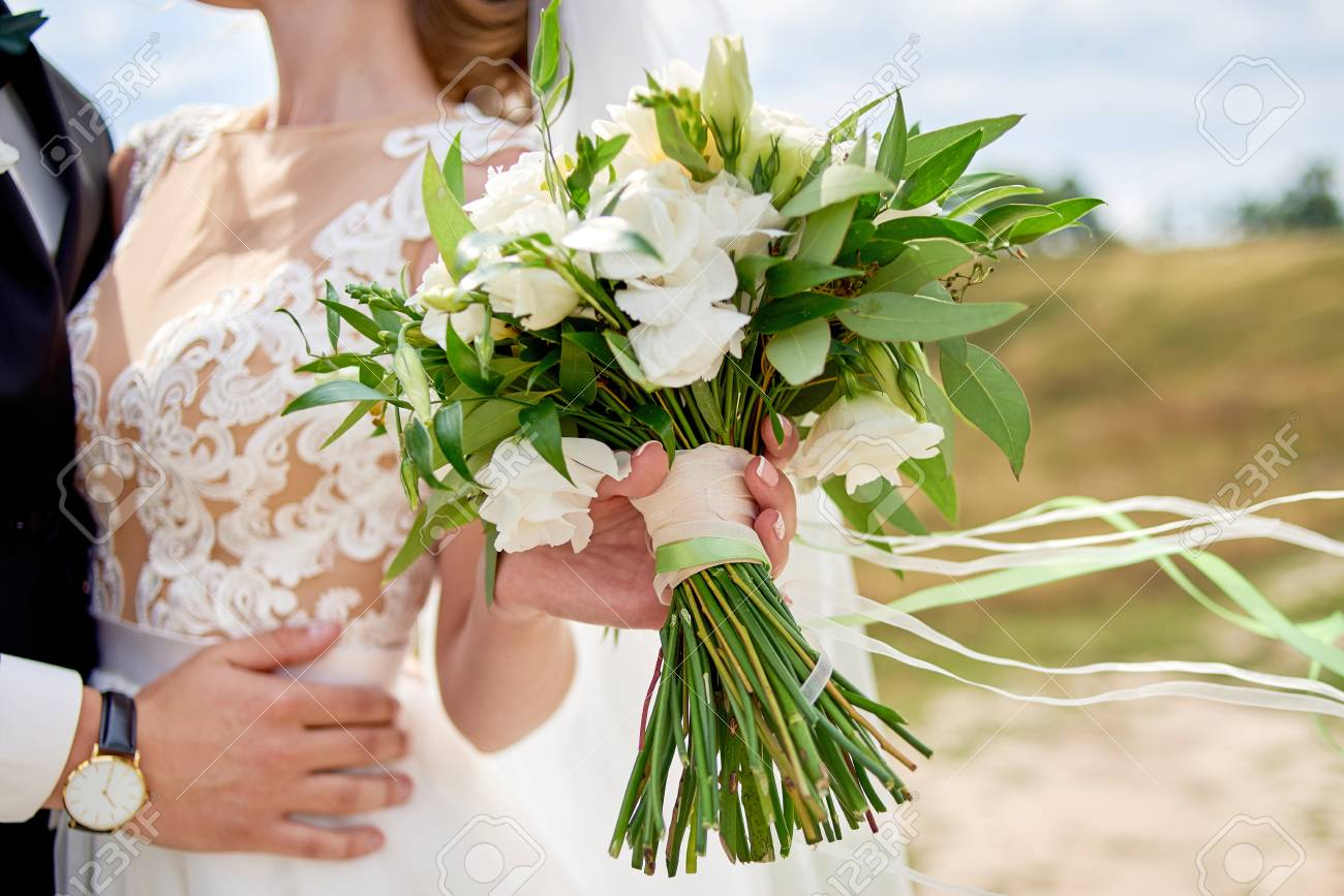 Beautiful Bridal Bouquet Of White Fresh Flowers And Greenery Stock