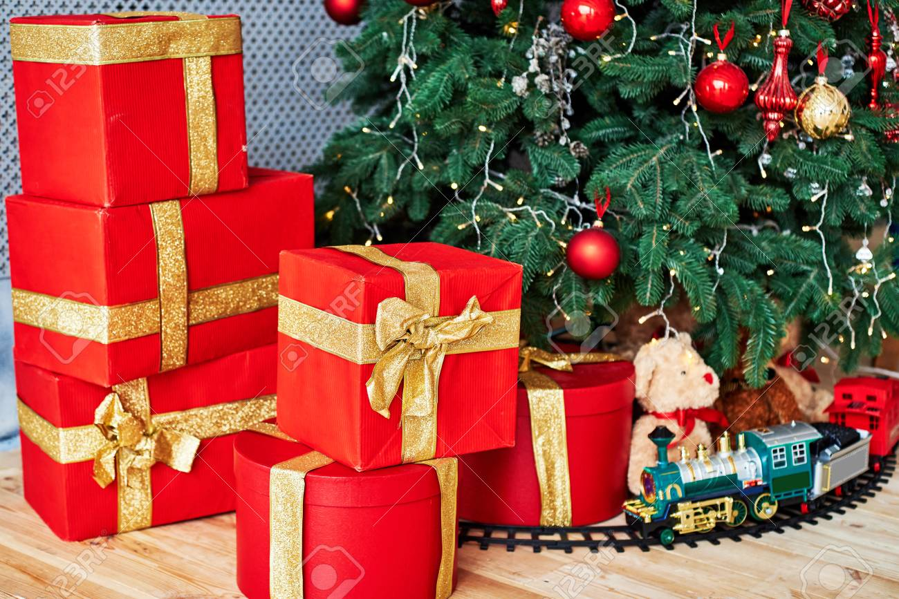 Christmas Background With Red Gift Boxes Decorated With Golden Stock Photo Picture And Royalty Free Image Image 110982352
