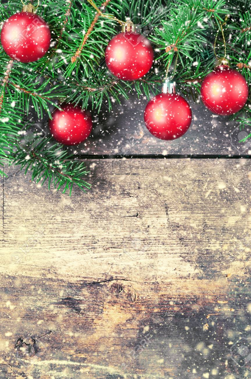 Christmas Tree Fruit Ornaments.Branches Of A Christmas Tree On Old Boards Christmas Background
