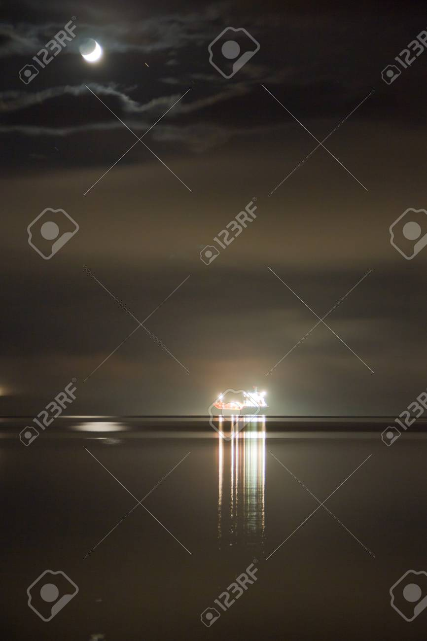 the ship is at anchor off the coast of Stock Photo - 10267638