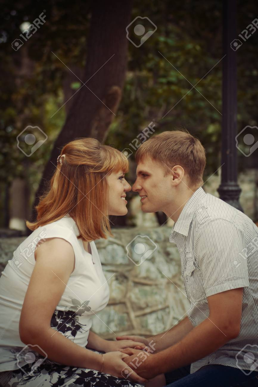 young pregnant woman and her husband walk in the park Stock Photo - 12047732