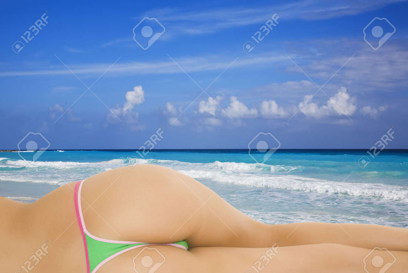 A very sexy caucasian woman enjoying the turquoise waters and white sand beaches of Cancun on the Yucatan Peninsula in Quintana Roo Mexico Stock Photo - 2242767