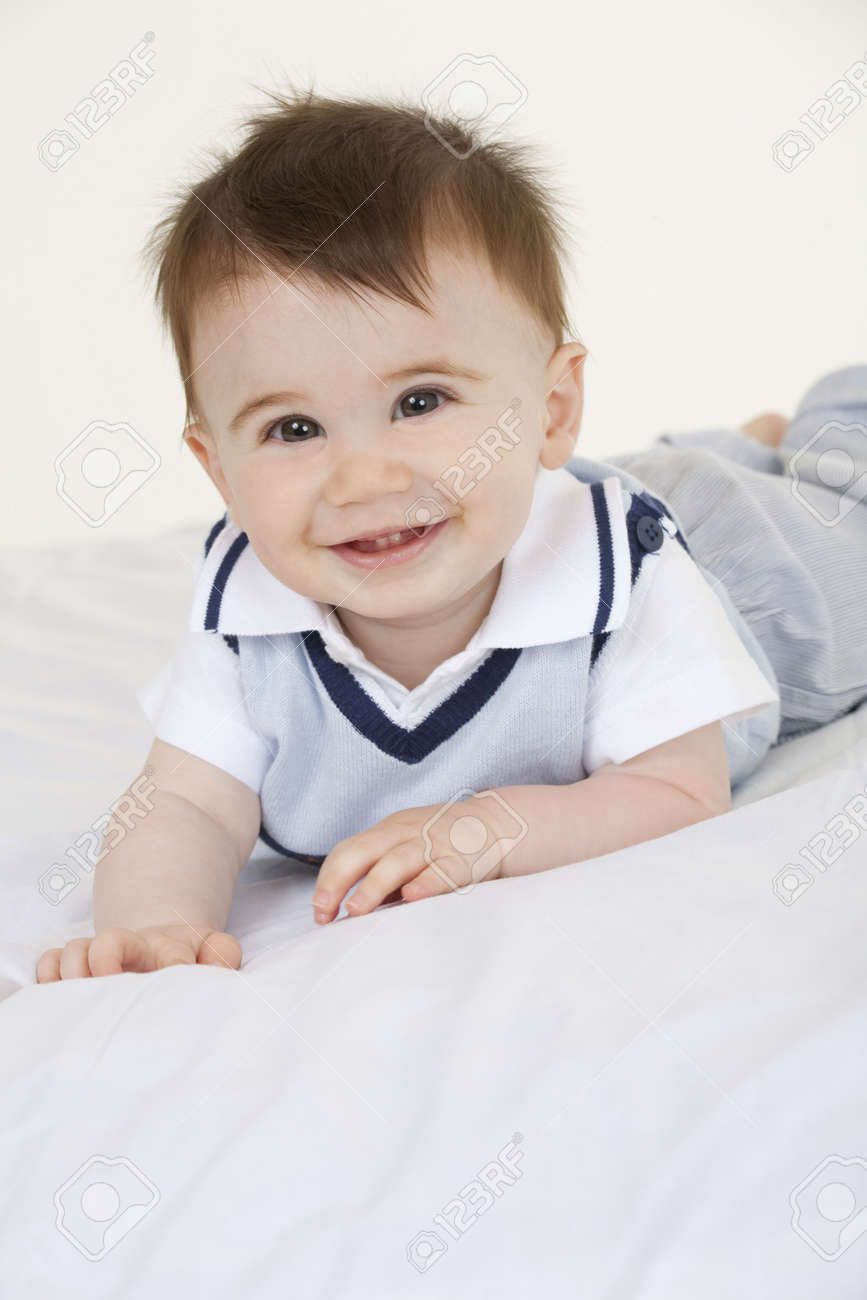 a very cute happy caucasian baby boy stock photo, picture and