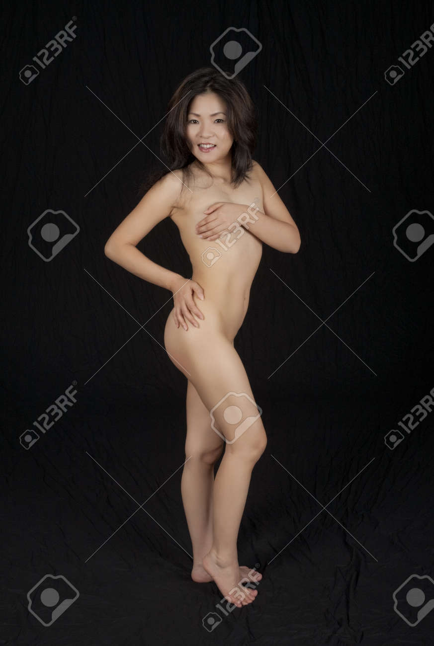 beautiful japanese wife nude - Beautiful and sexy Japanese woman posing nude and implied nude on a black  background Stock Photo