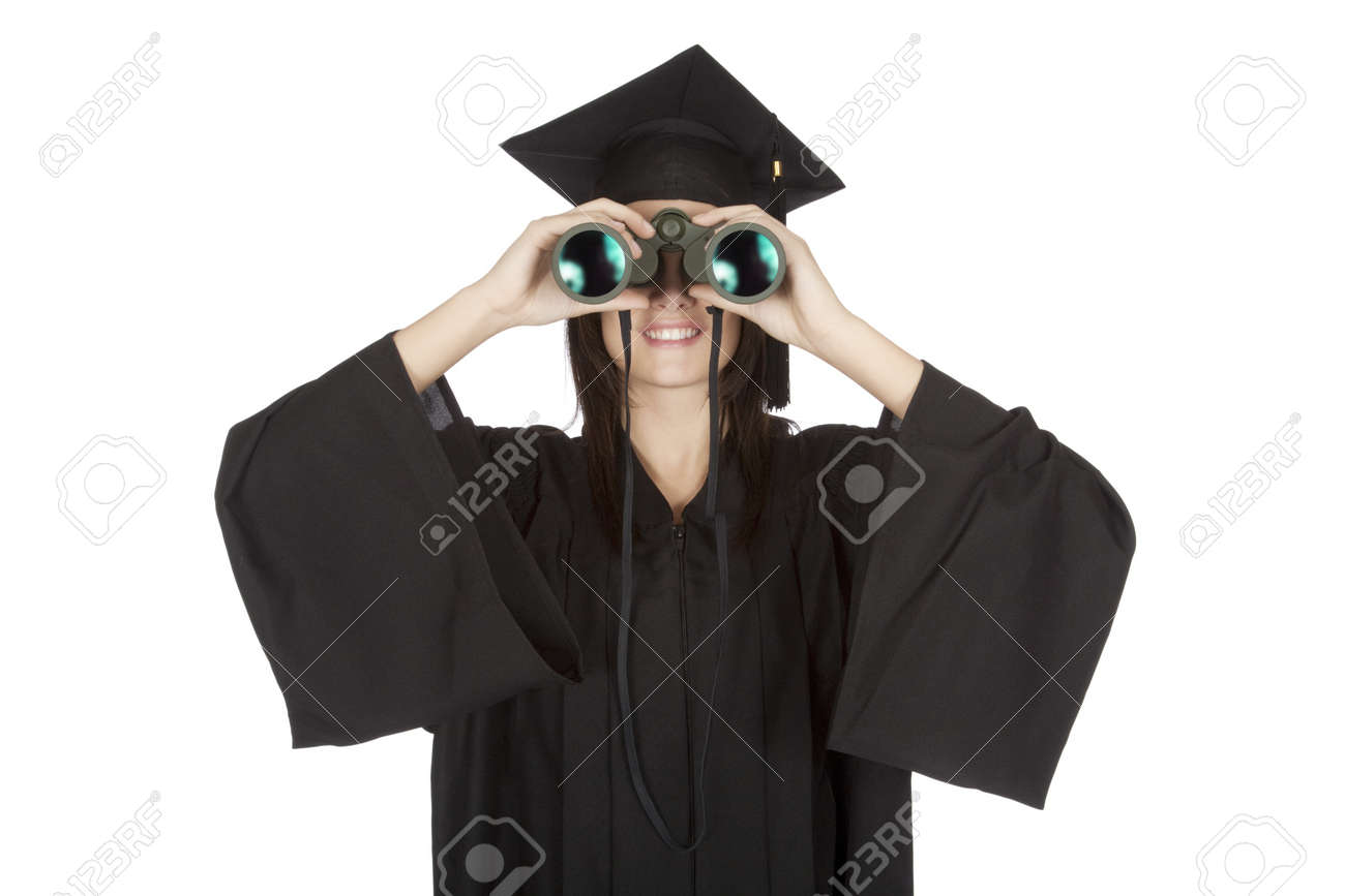 Beautiful Caucasian woman wearing in a black graduation gown and looking through binoculars Stock Photo - 8703053