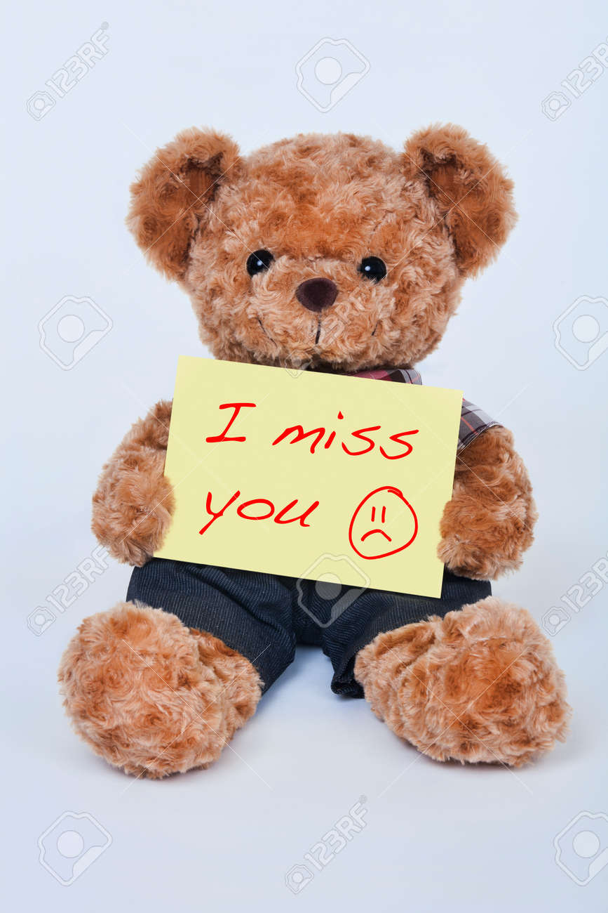 Miss you stock photos royalty free miss you images a cute teddy bear holding a yellow sign that says i miss you isolated on a altavistaventures Gallery