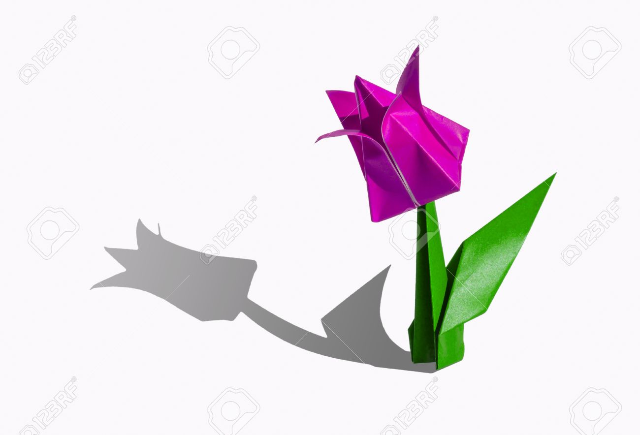 Origami tulip flower the tulip is isolated on white background origami tulip flower the tulip is isolated on white background and casts shadow on the jeuxipadfo Image collections