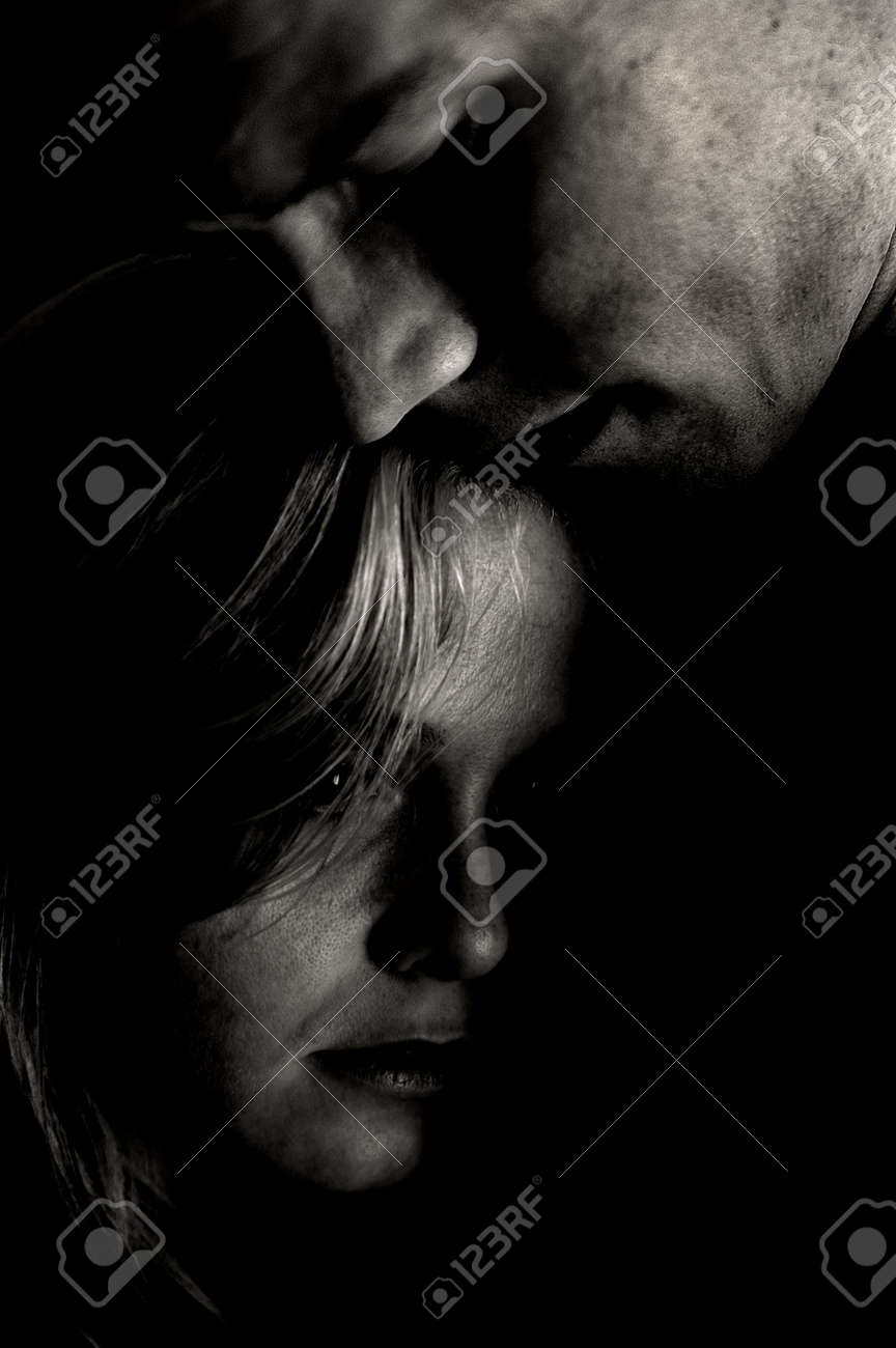Couple in black and white being intimate stock photo 998572