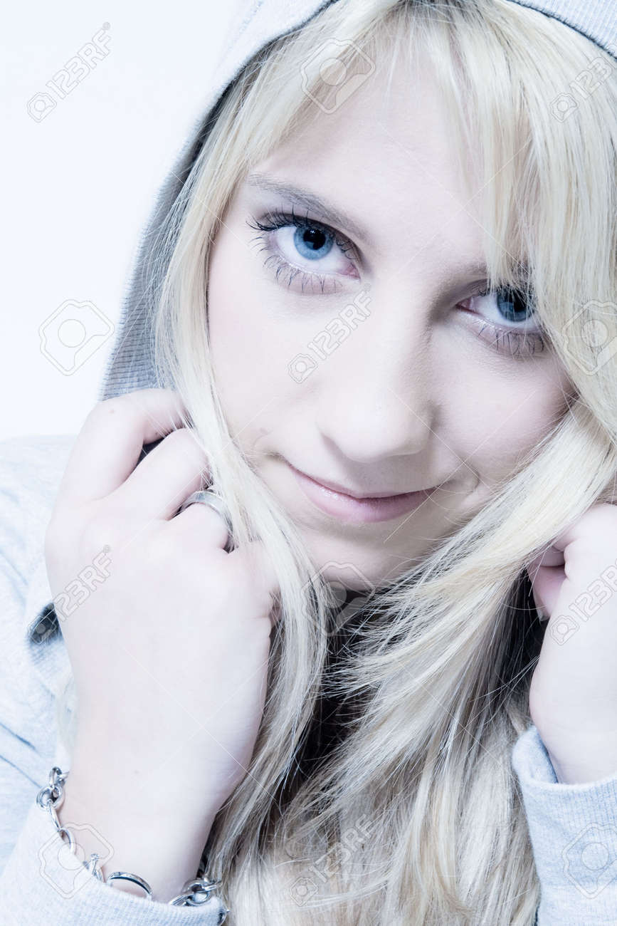 Studio portrait of a long blond girl looking friendly Stock Photo - 2263546