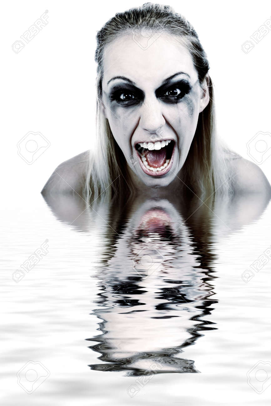 Studio portrait of a young blond woman in horror - 3266151