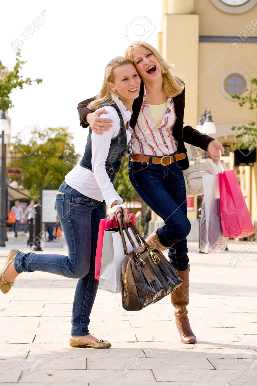 Two young girls shopping in the sunny weather Stock Photo - 3688194