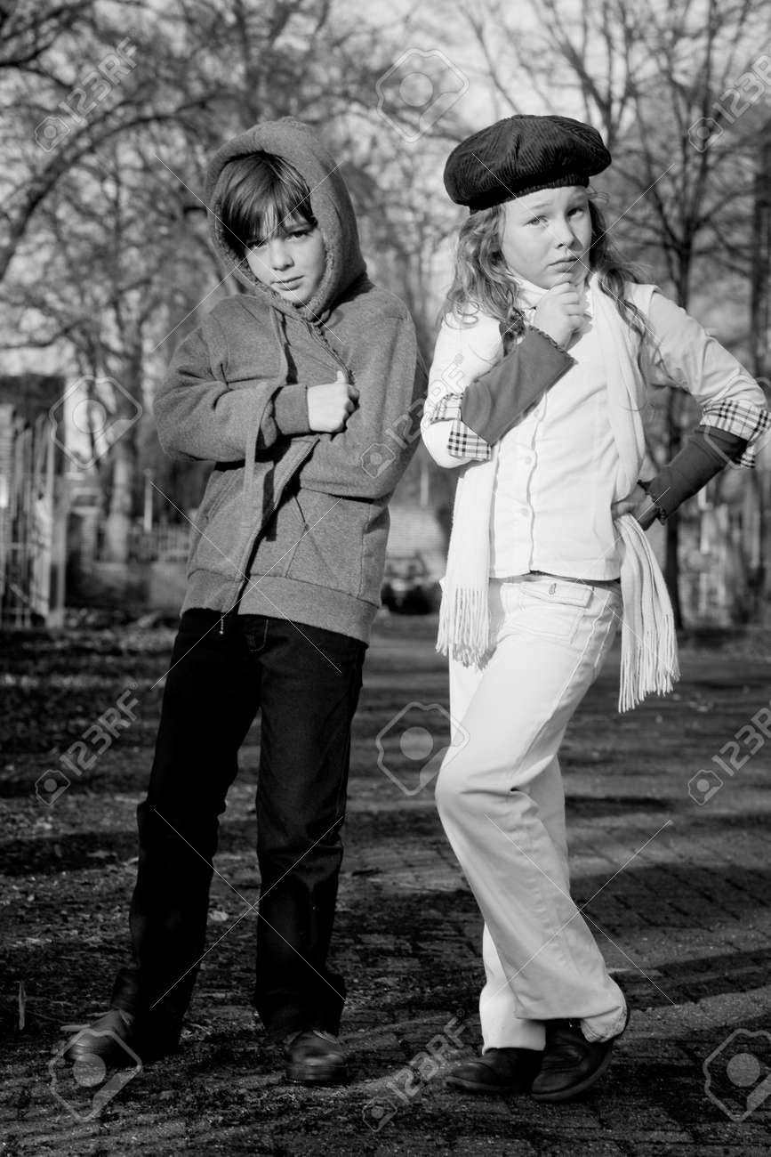 Young boy and girl with a big fashion attitude Stock Photo - 3997316