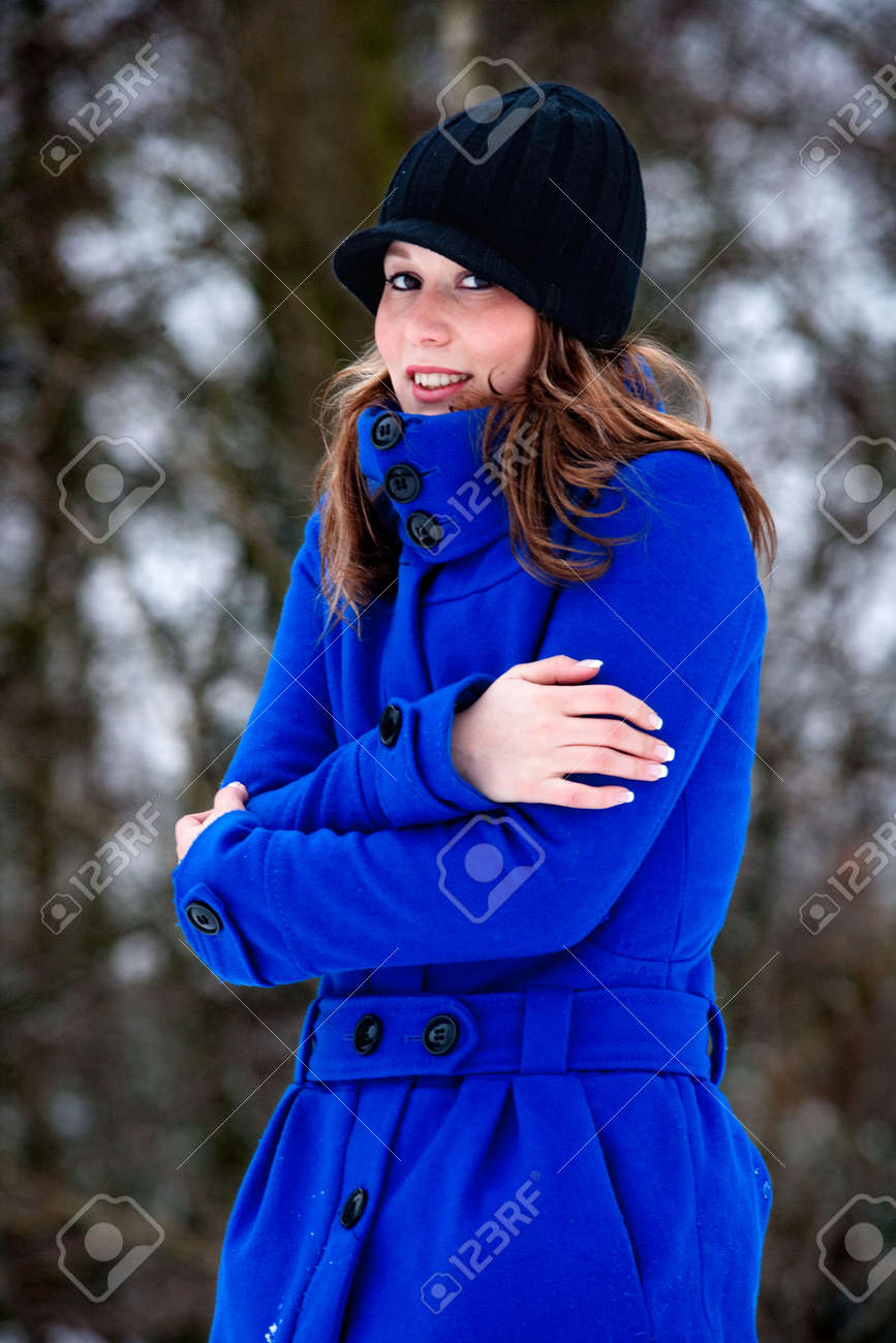 Freezing Cold Girl In Blue Winter Coat Stock Photo Picture And