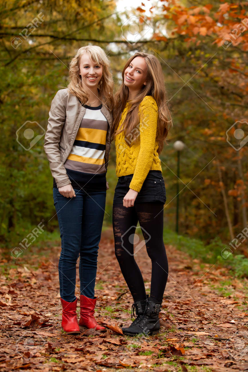 2 girls are having fun in the forest Stock Photo - 16640128