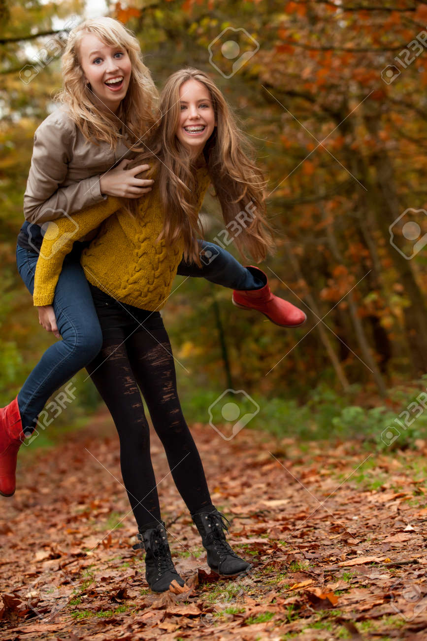 2 girls are having fun in the forest Stock Photo - 16640121