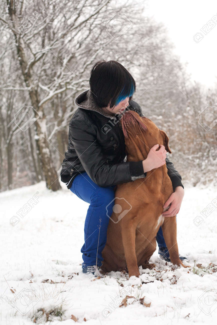 Funky boy is having fun with his dog in the snow Stock Photo - 19167314