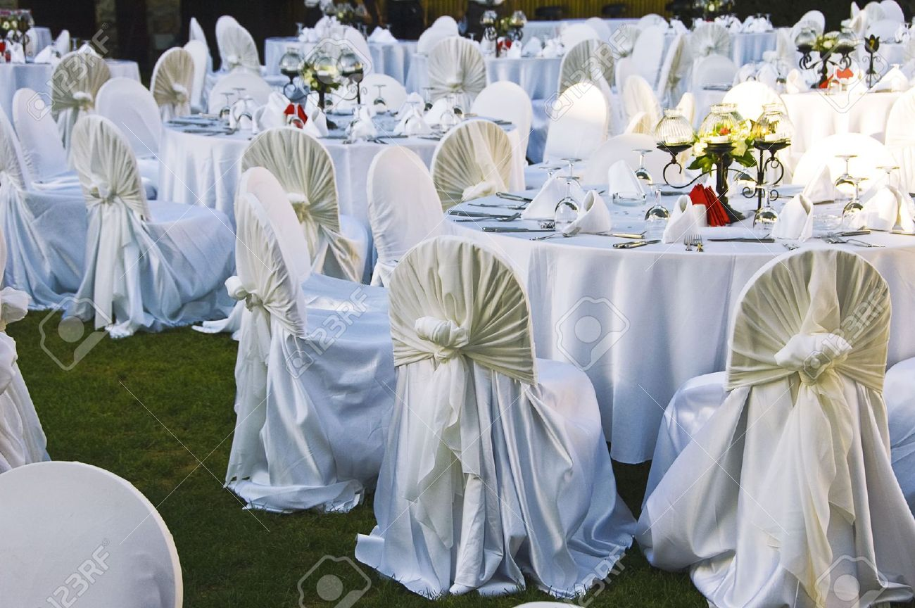 Wedding chairs and covers at an outdoor wedding stock photo wedding chairs and covers at an outdoor wedding stock photo 5328829 junglespirit Choice Image