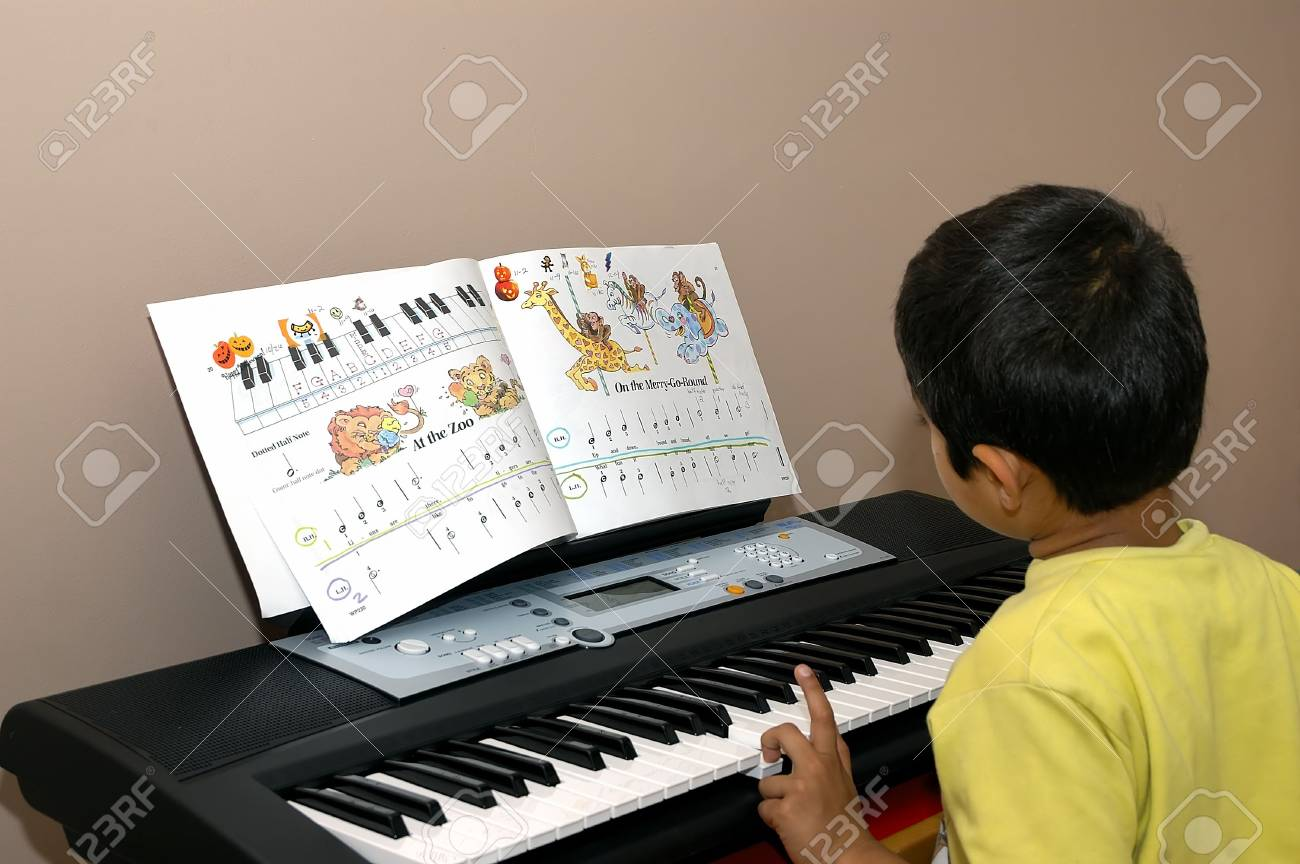 A kid is diligently practicing pianing Stock Photo - 671711